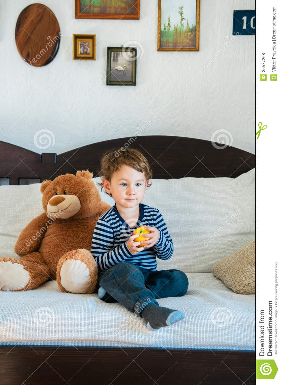 boy at home holding apple royalty free stock photos