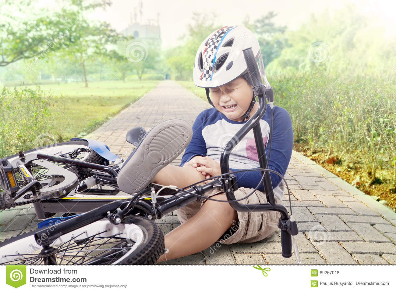 Boy Hurt After Falling Off His Bicycle Stock Photo - Image ...