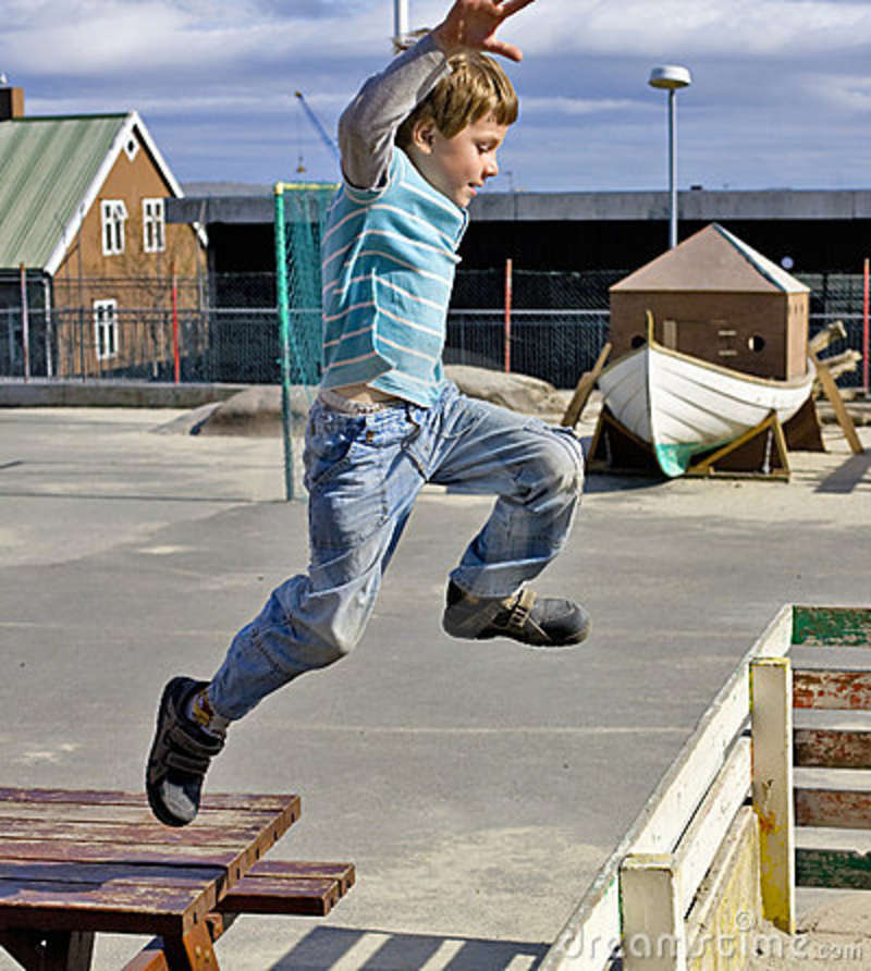 Boy Jumping Over The Fence Stock Photo Image Of Fence