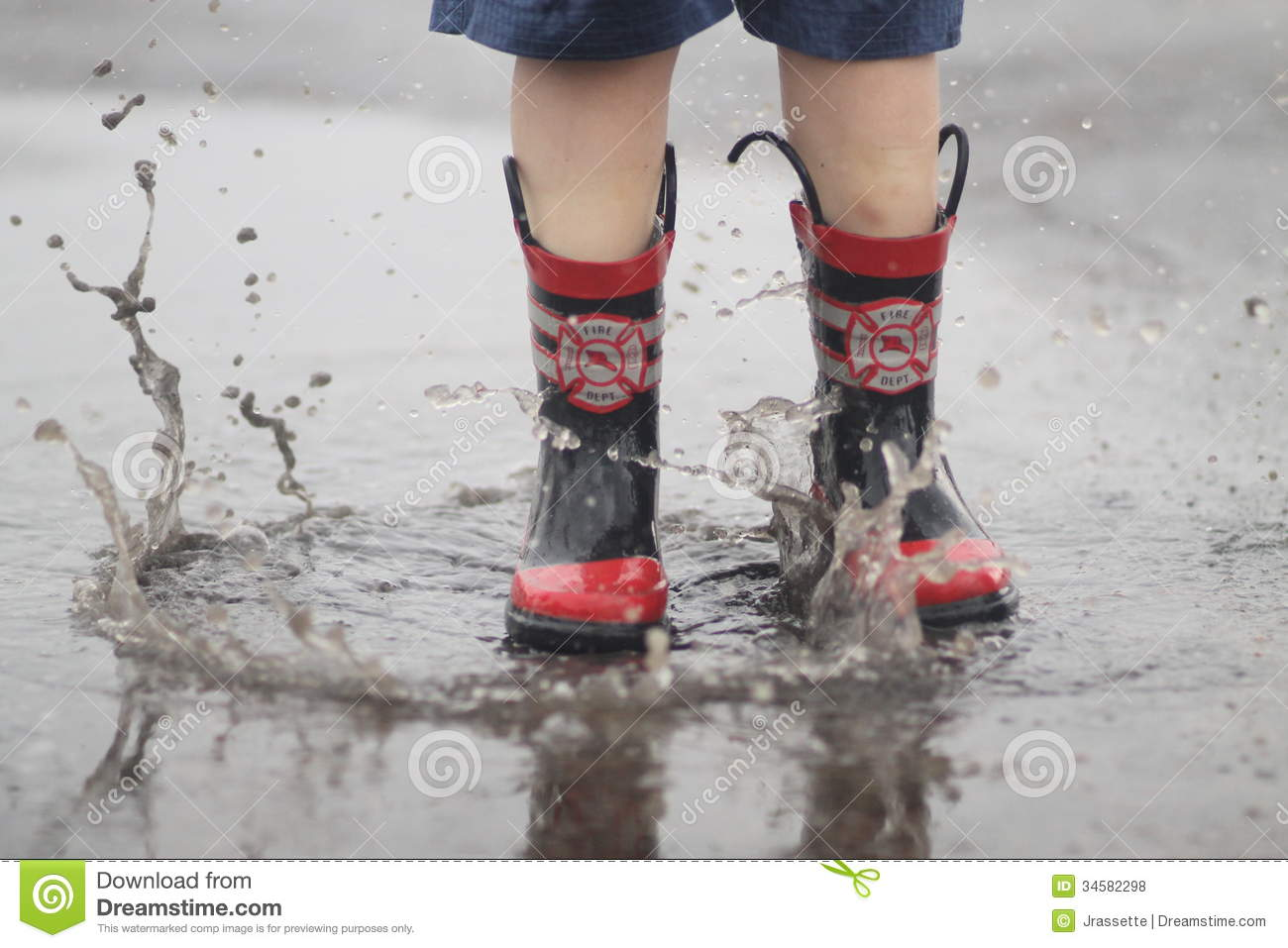 Rain Boots In Puddle