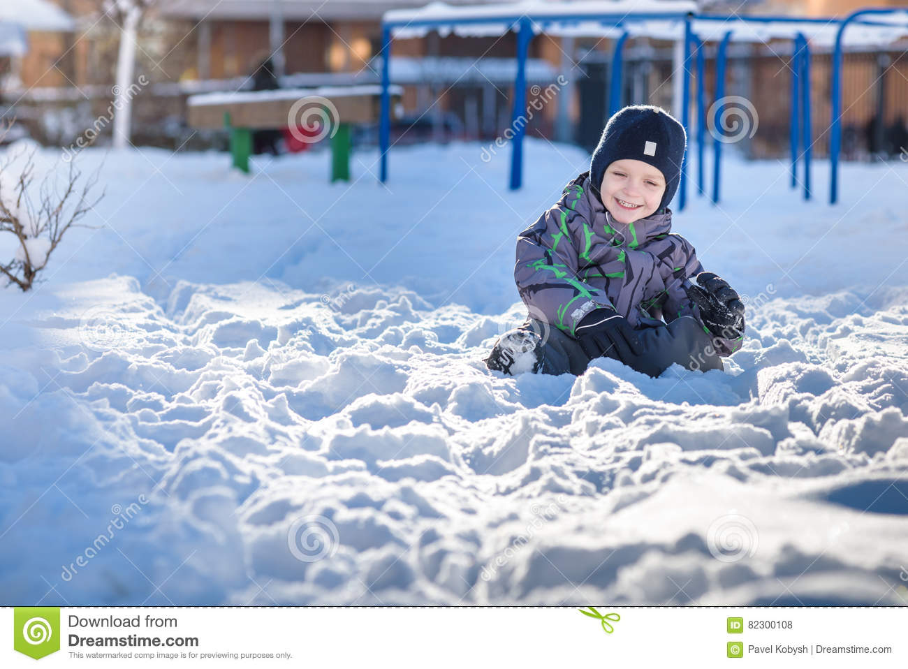 4c6190687be boy-jumping-snow-happy-kid-walking-outdoors-winter -city-child-smiling-having-fun-82300108.jpg
