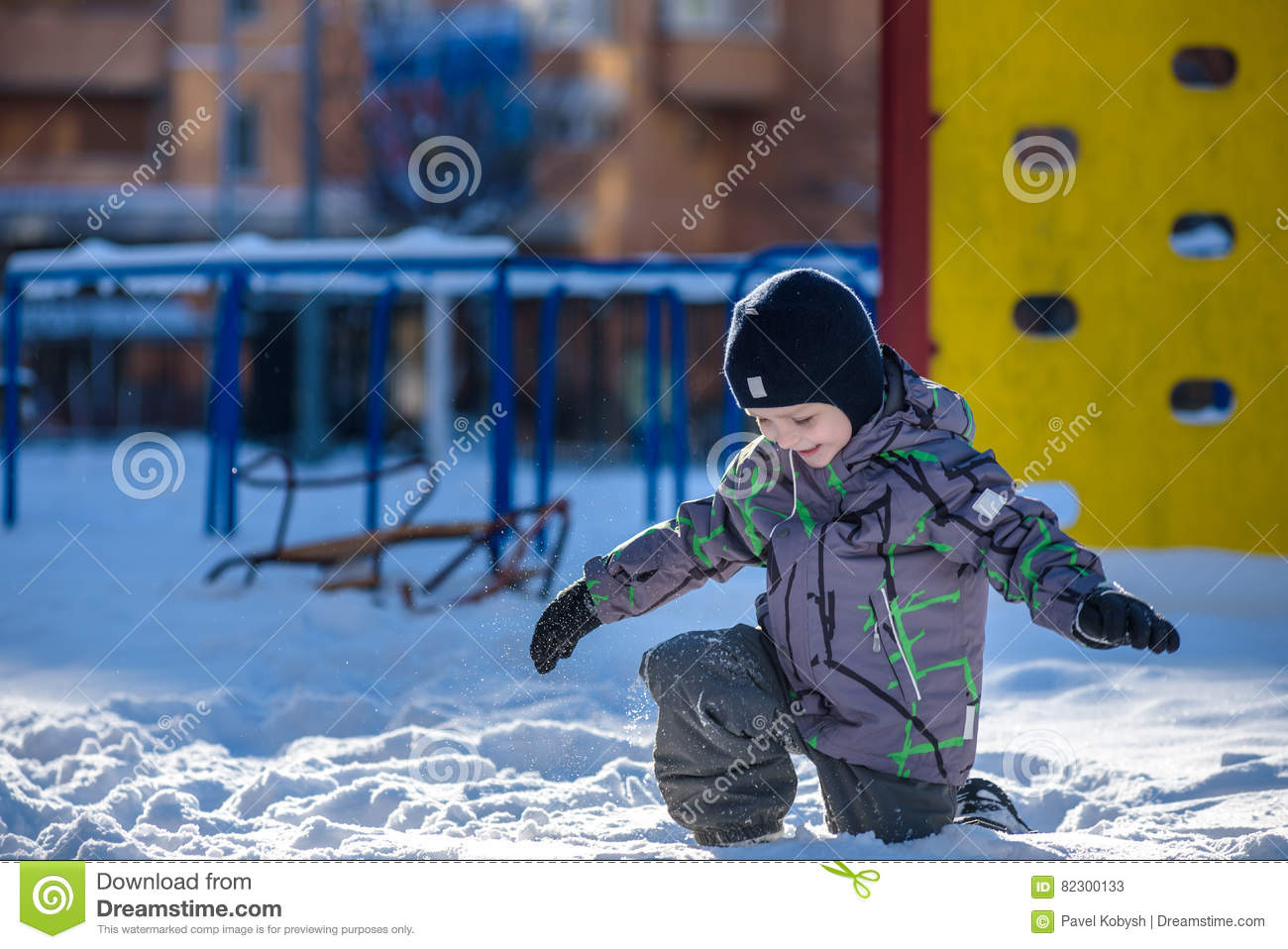 6575cca4d43 boy-jumping-snow-happy-kid-walking-outdoors-winter -city-child-smiling-having-fun-82300133.jpg