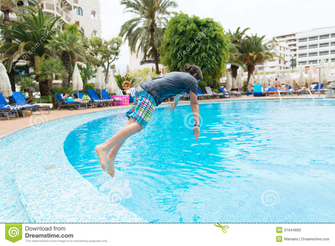 Boy jumping into swimming pool stock image image 31944683 for Wearing t shirt in swimming pool