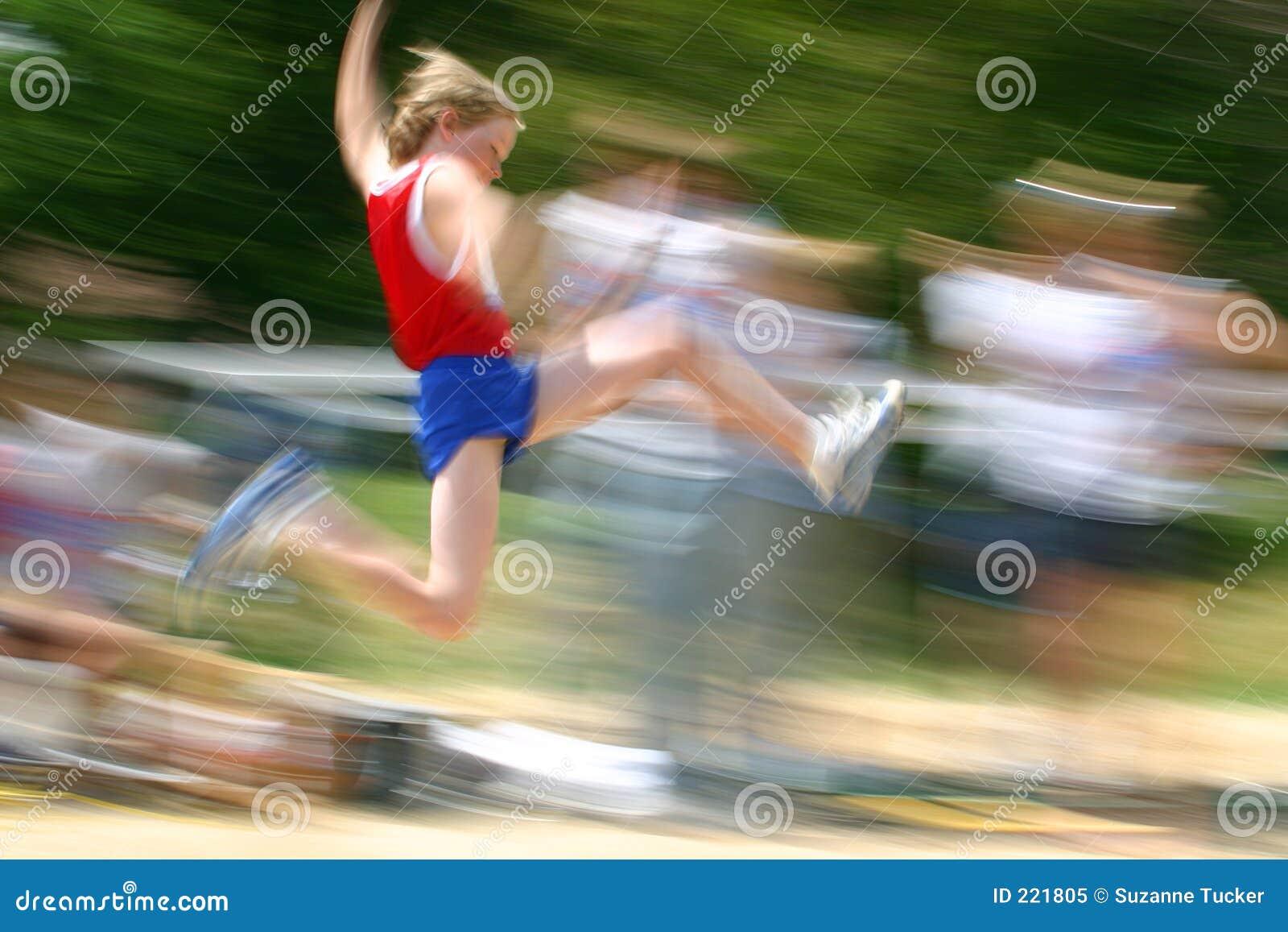 Boy jumping at track meet /motion blur