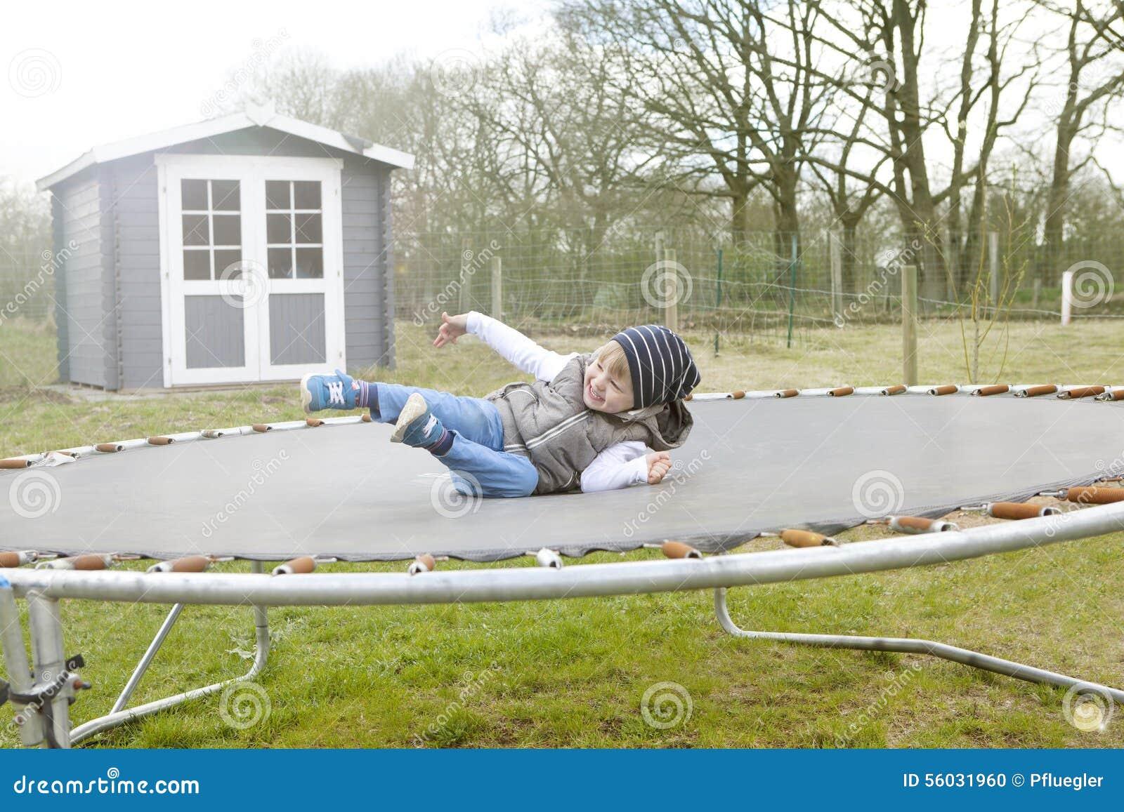 Boy Jumping Trampoline Stock Image