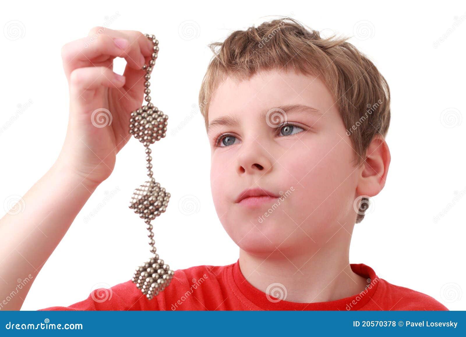 Boy Keep Cubes Of Metal Balls Royalty Free Stock Photos - Image ...