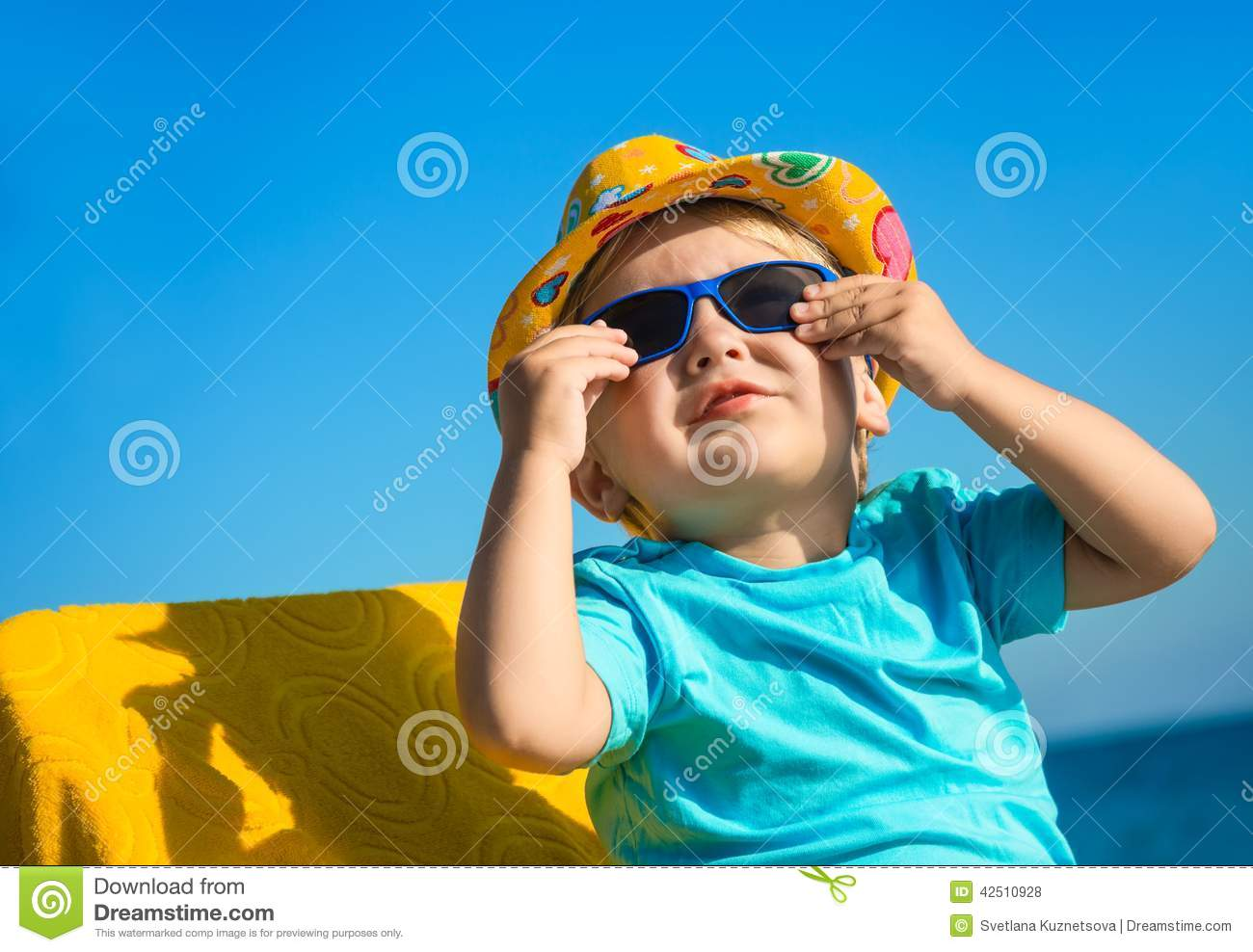 Boy Kid In Sun Glasses And Hat On Beach Stock Photo