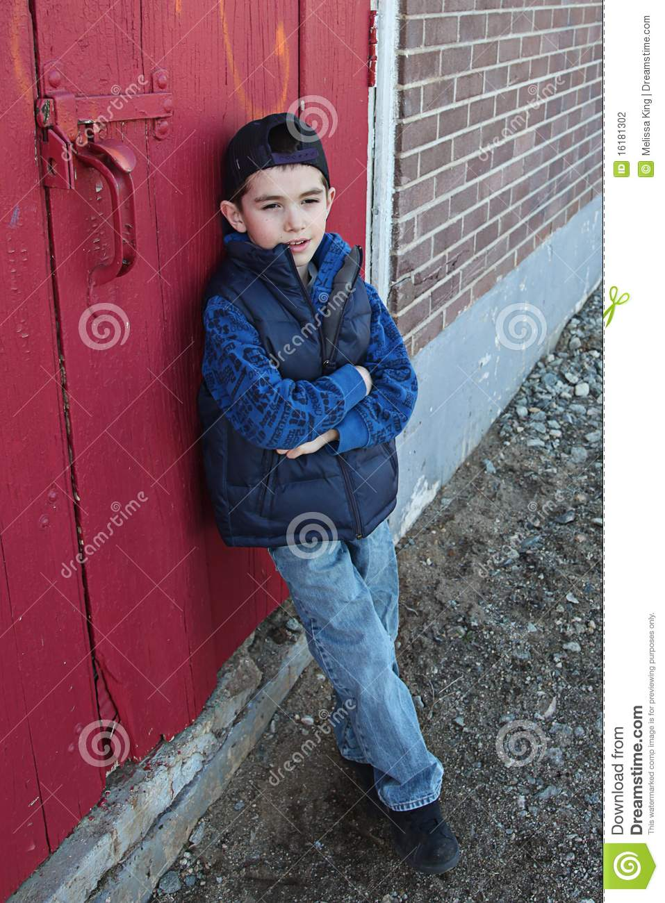 Boy Leaning Against Door Stock Photo Image Of Arms