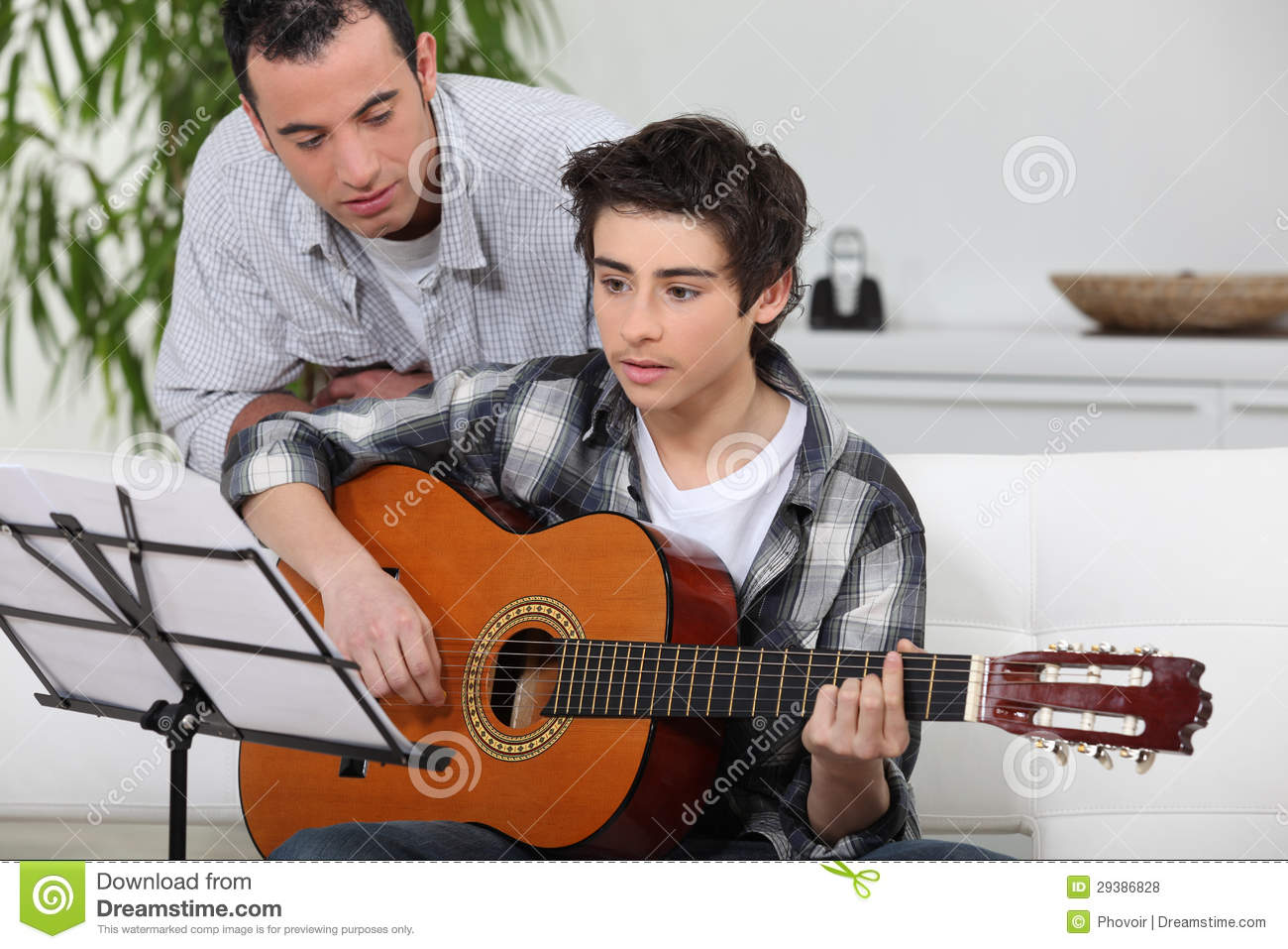 boy learning to play the guitar stock photo image of instrument caucasians 29386828. Black Bedroom Furniture Sets. Home Design Ideas