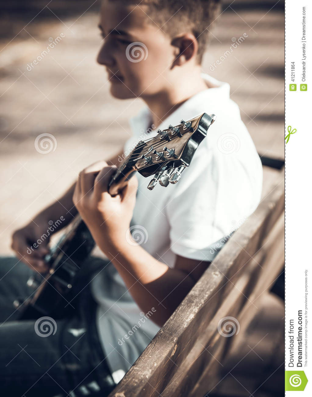 boy learning to play guitar stock photo image 41211864. Black Bedroom Furniture Sets. Home Design Ideas