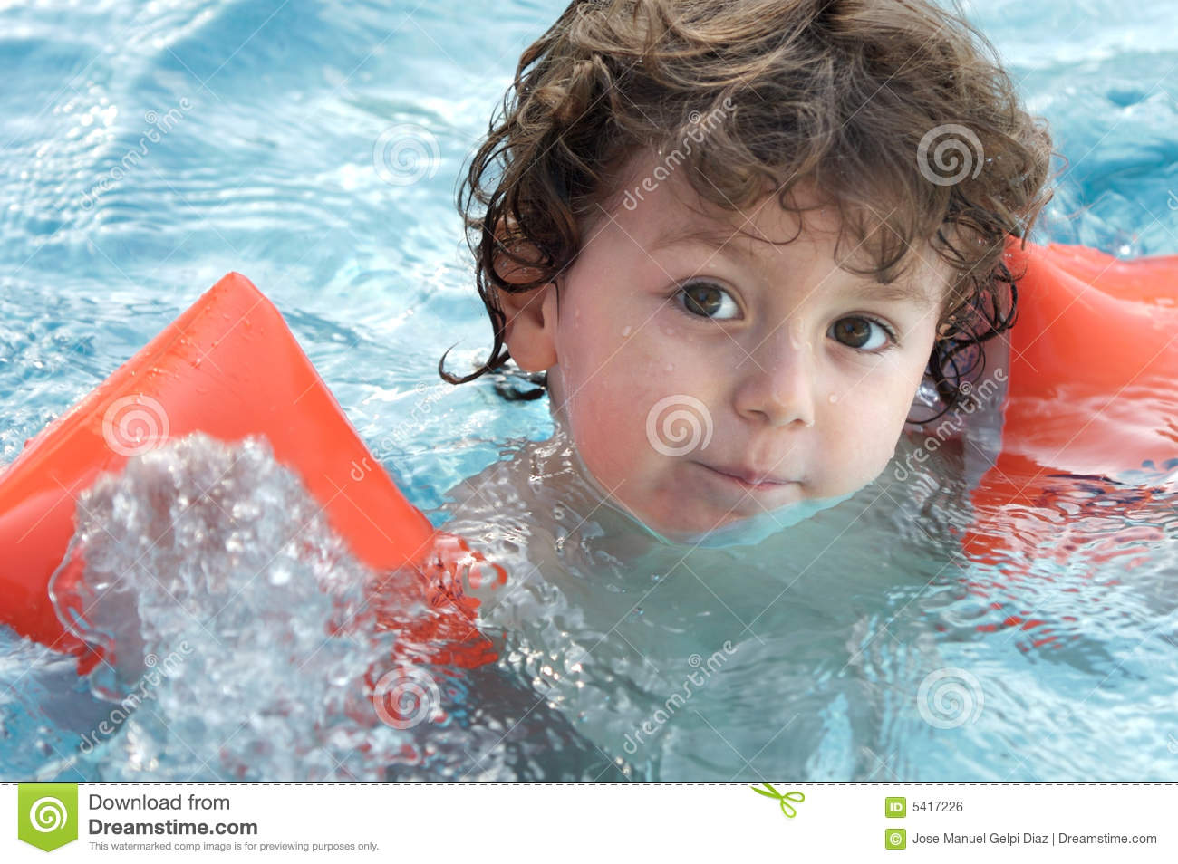 Boy learning to swim