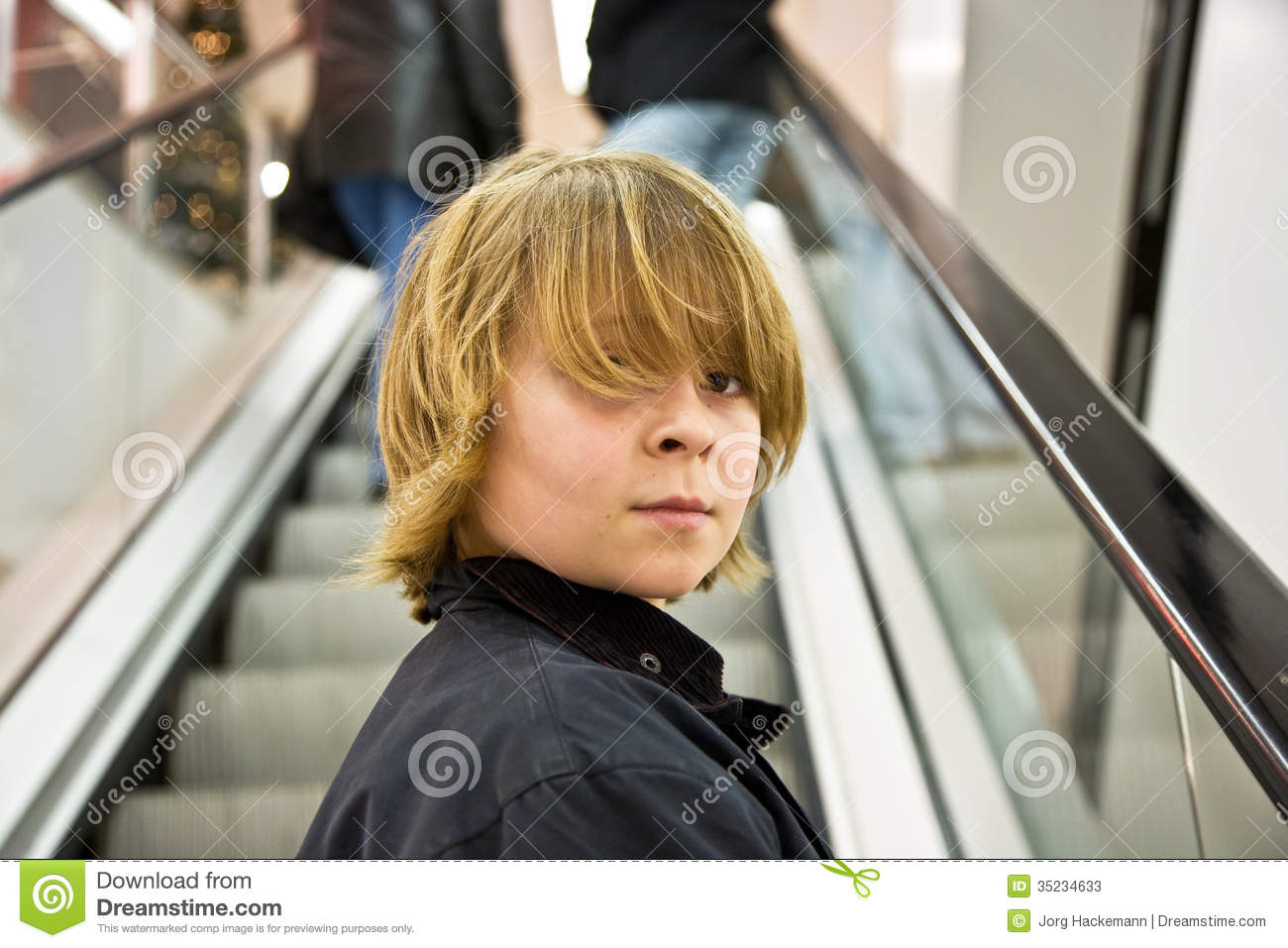 Boy With Long Blonde Hair On An Escalator Stock Image Image Of