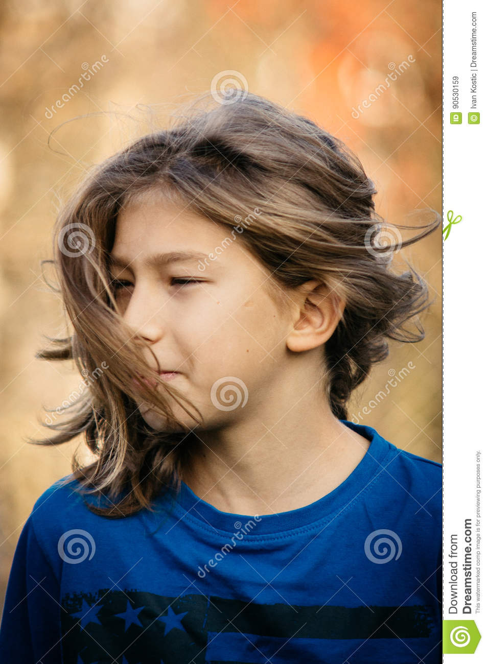 Teen Boy with long hair stock image. Image of blue, happy