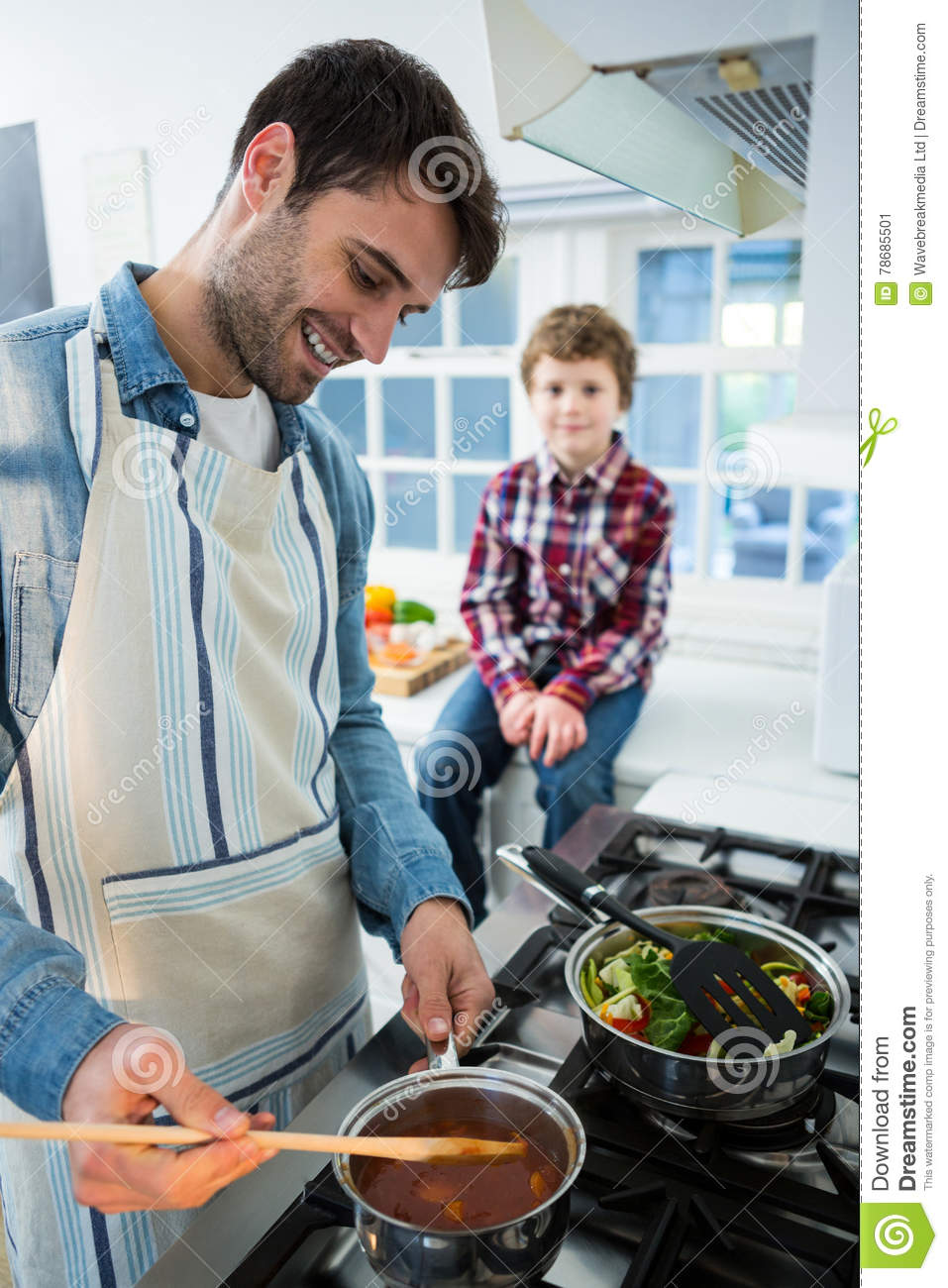 Boy Looking While Father Cooking Food Stock Image - Image of ...
