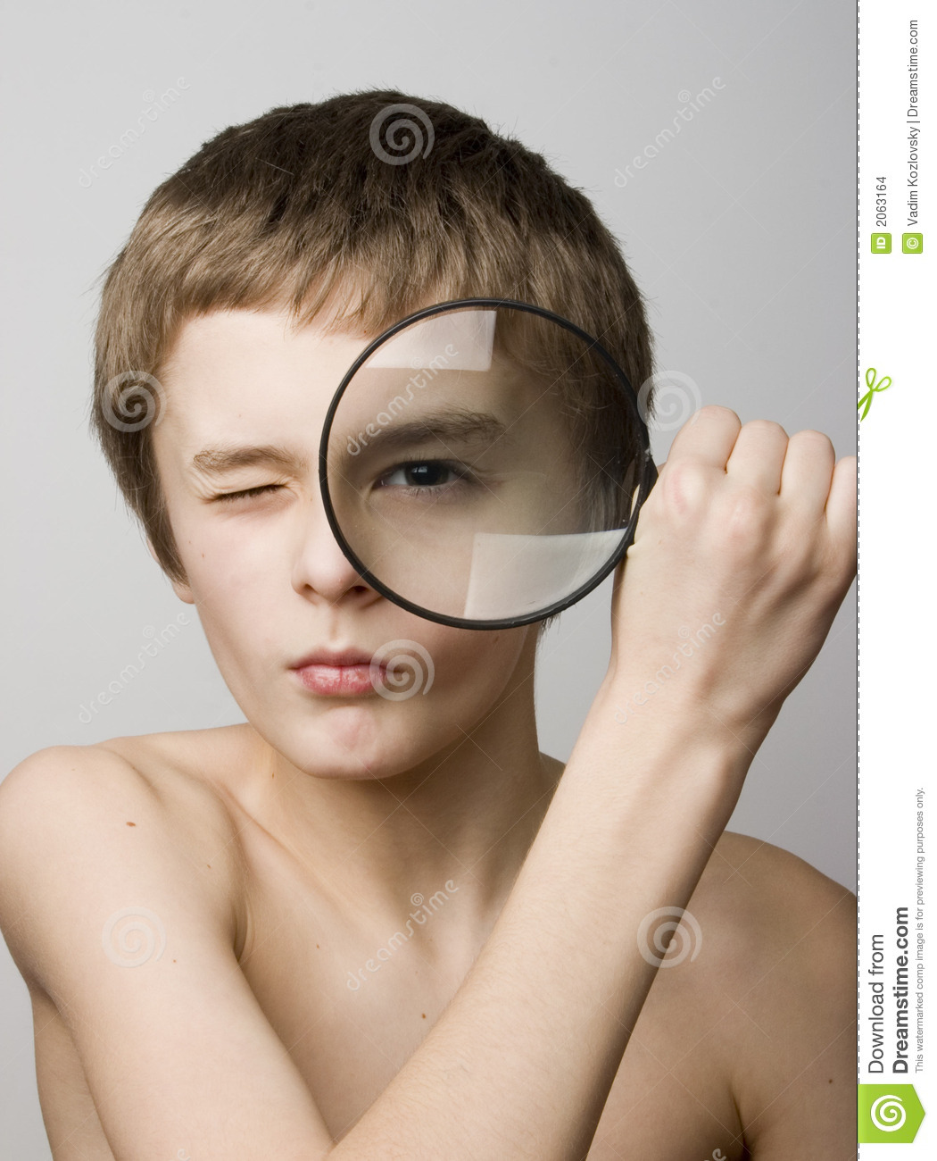 Boy Looking Through The Lens Stock Images - Image: 2063164