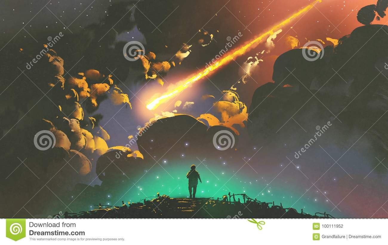 Boy looking the meteor in the colorful sky