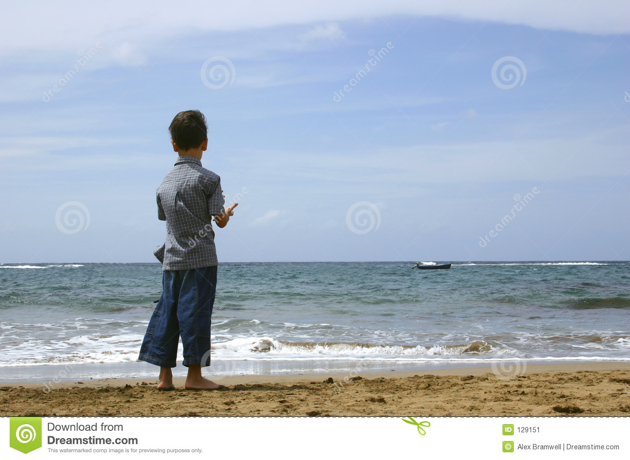boy looking at the ocean stock image