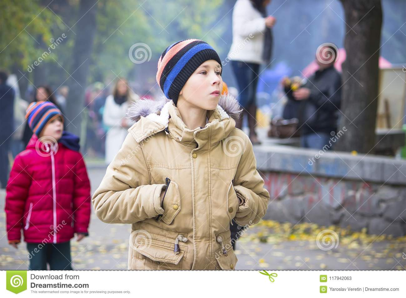 A boy looks out at event