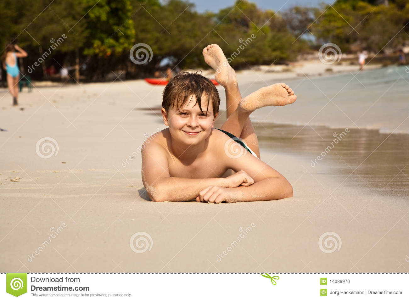 Boy Is Lying At The Beautiful Beach Stock Photo - Image of ... - photo#46