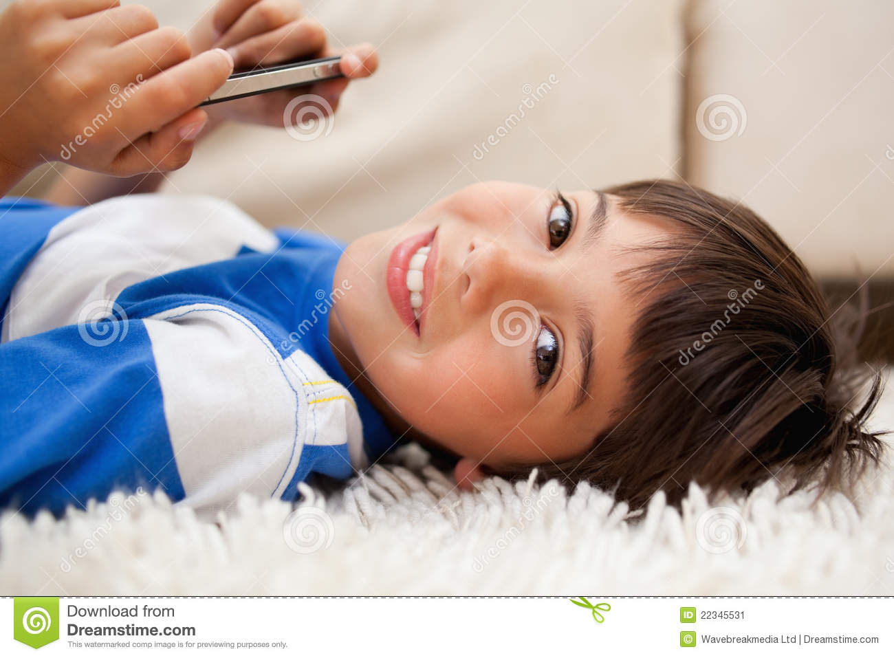 Boy Lying On The Carpet With Cellphone Stock Image Image 22345531