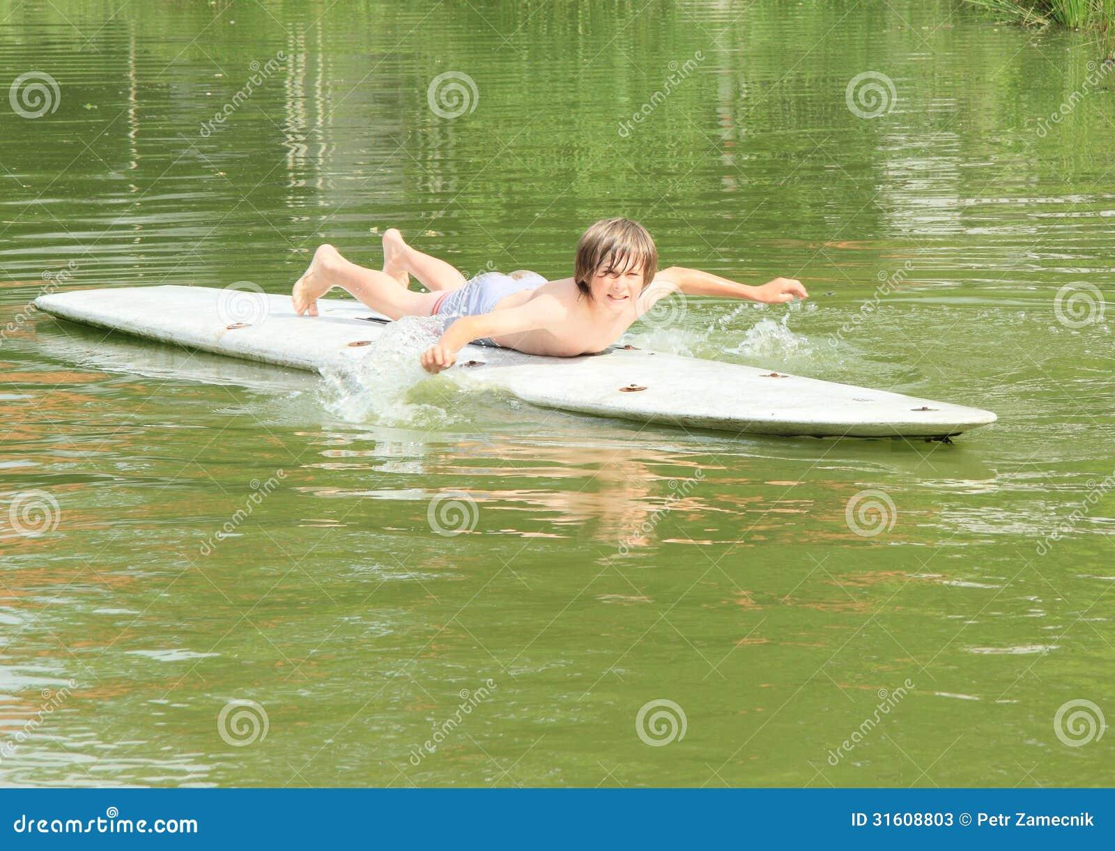 Boy Lying On A Surf Stock Photos Image 31608803
