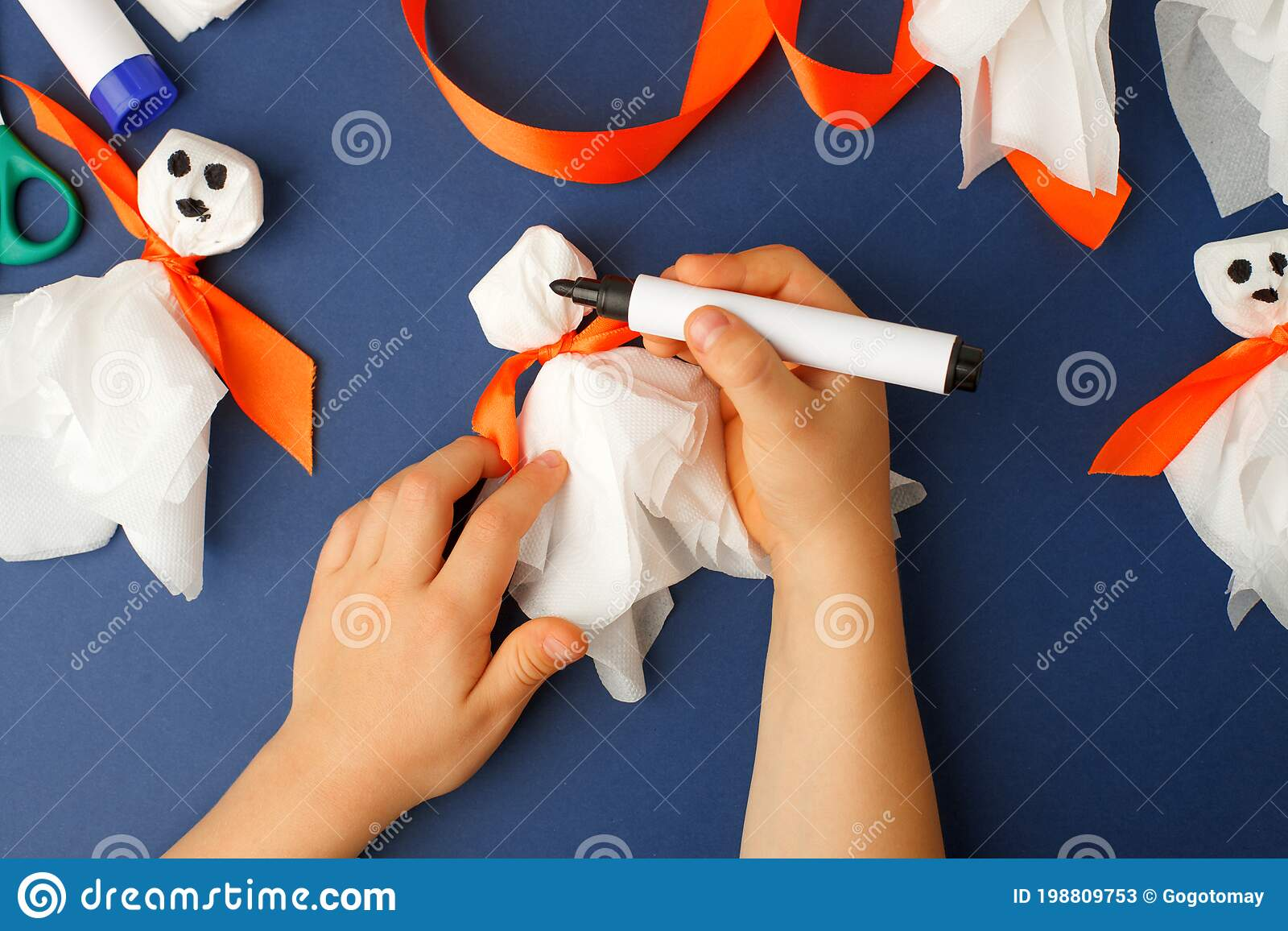 Boy Makes Halloween Toys Ghost From White Paper Napkin Creative Diy For Kids On Classic Blue Background Home Decor Project Party Stock Image Image Of Creativity Handcraft 198809753