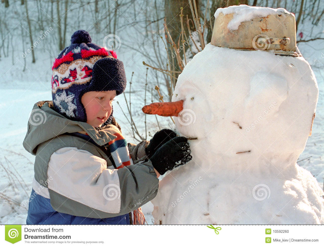 Boy making snowman stock photo image of activity outdoor for How to make a snowman