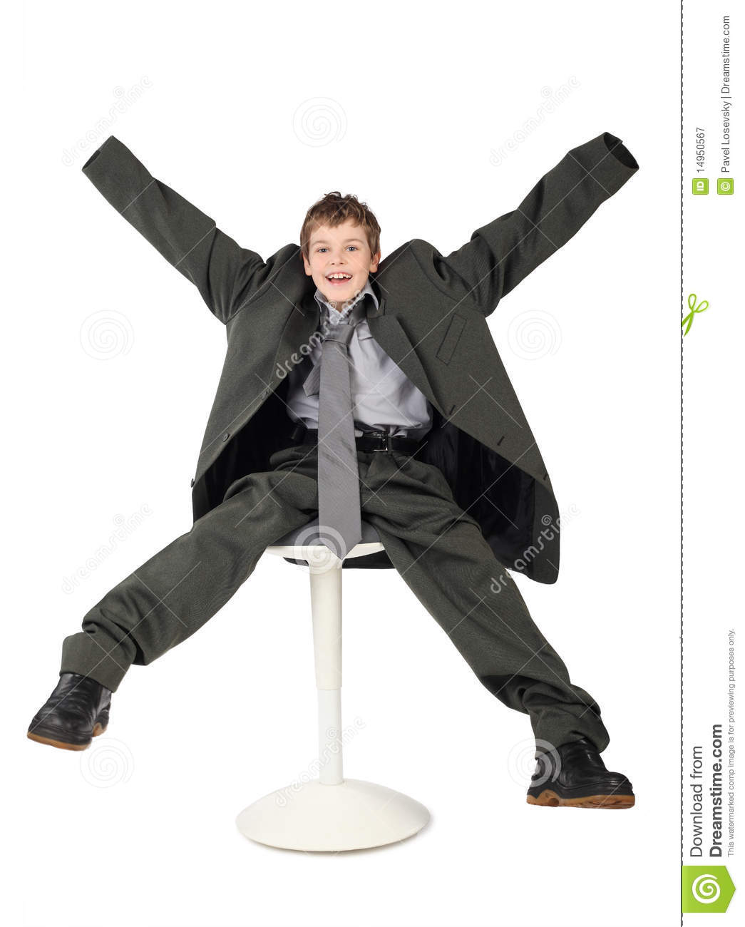 Boy in man s suit sitting on chair and smiling