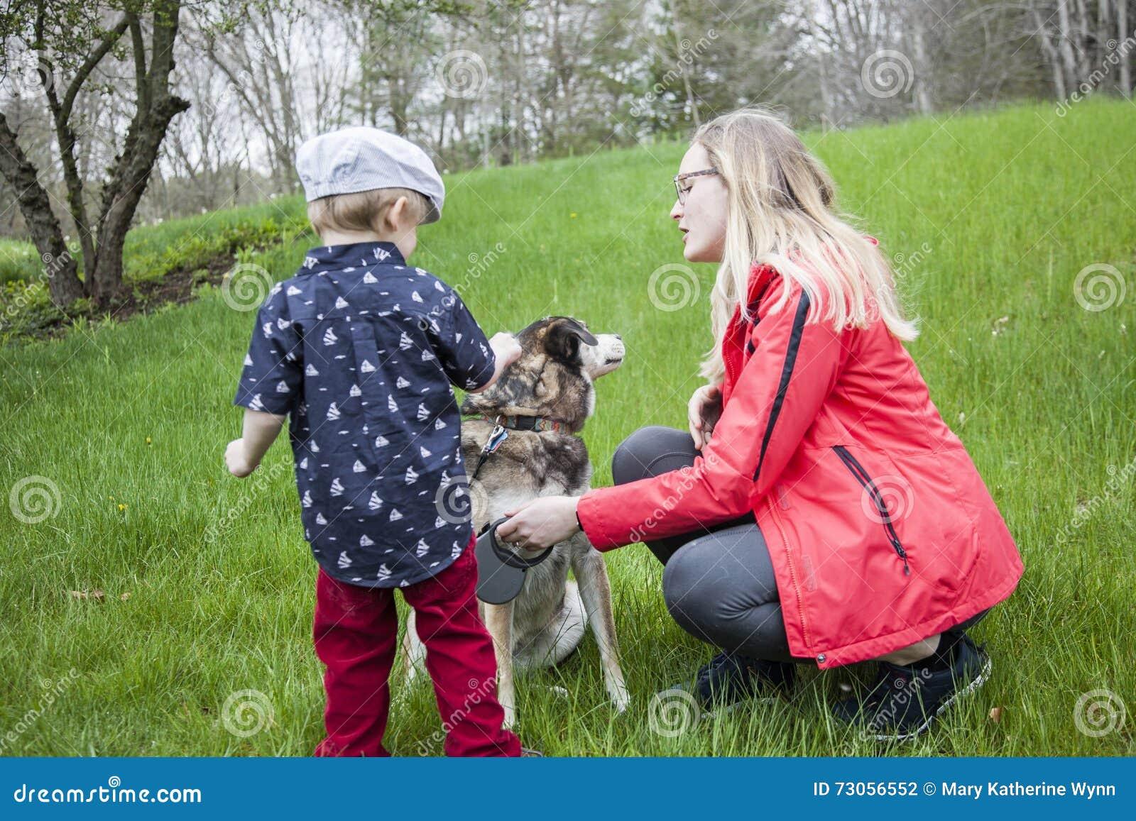 Boy meeting a new dog