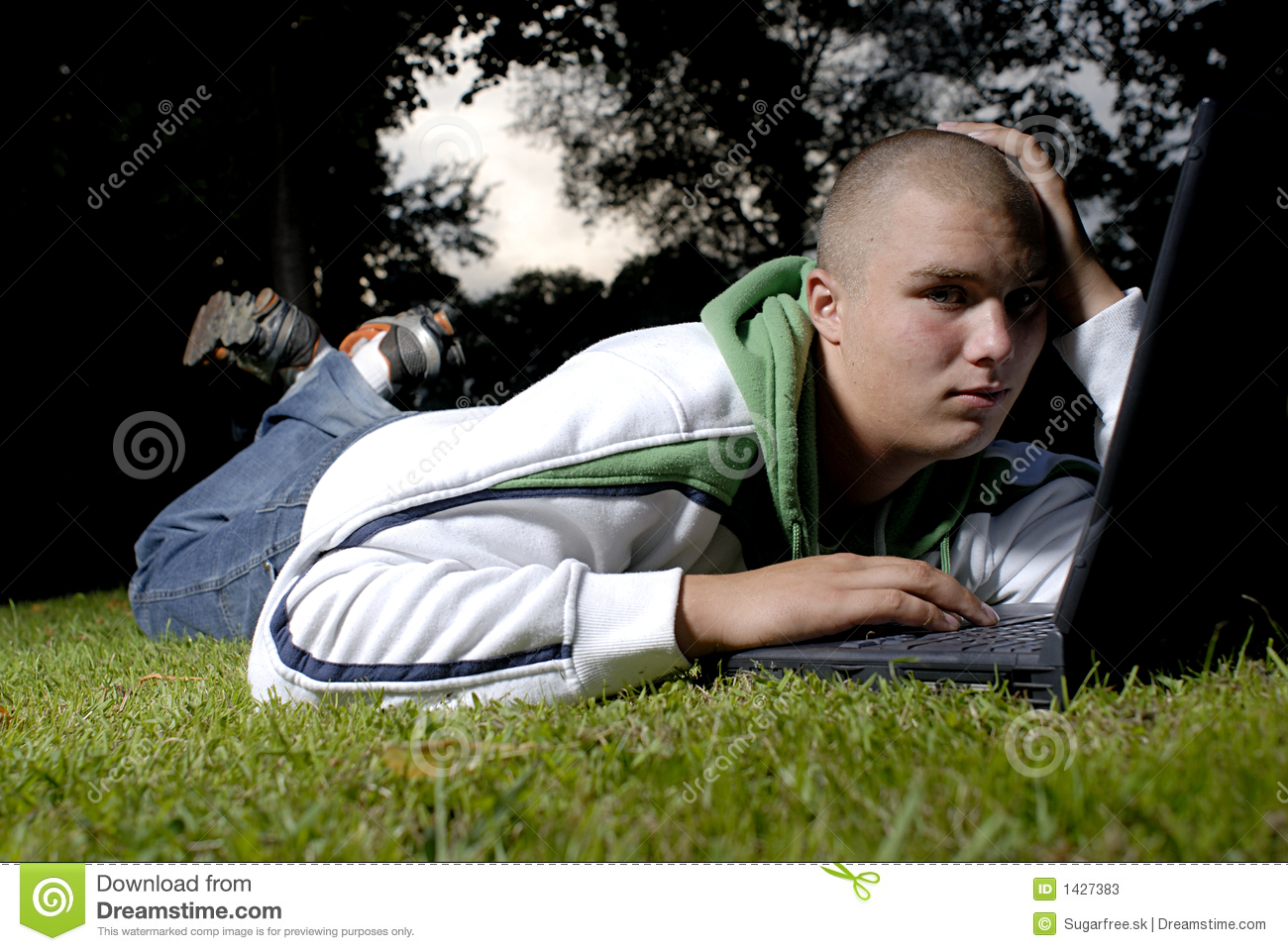Boy with notebook in park