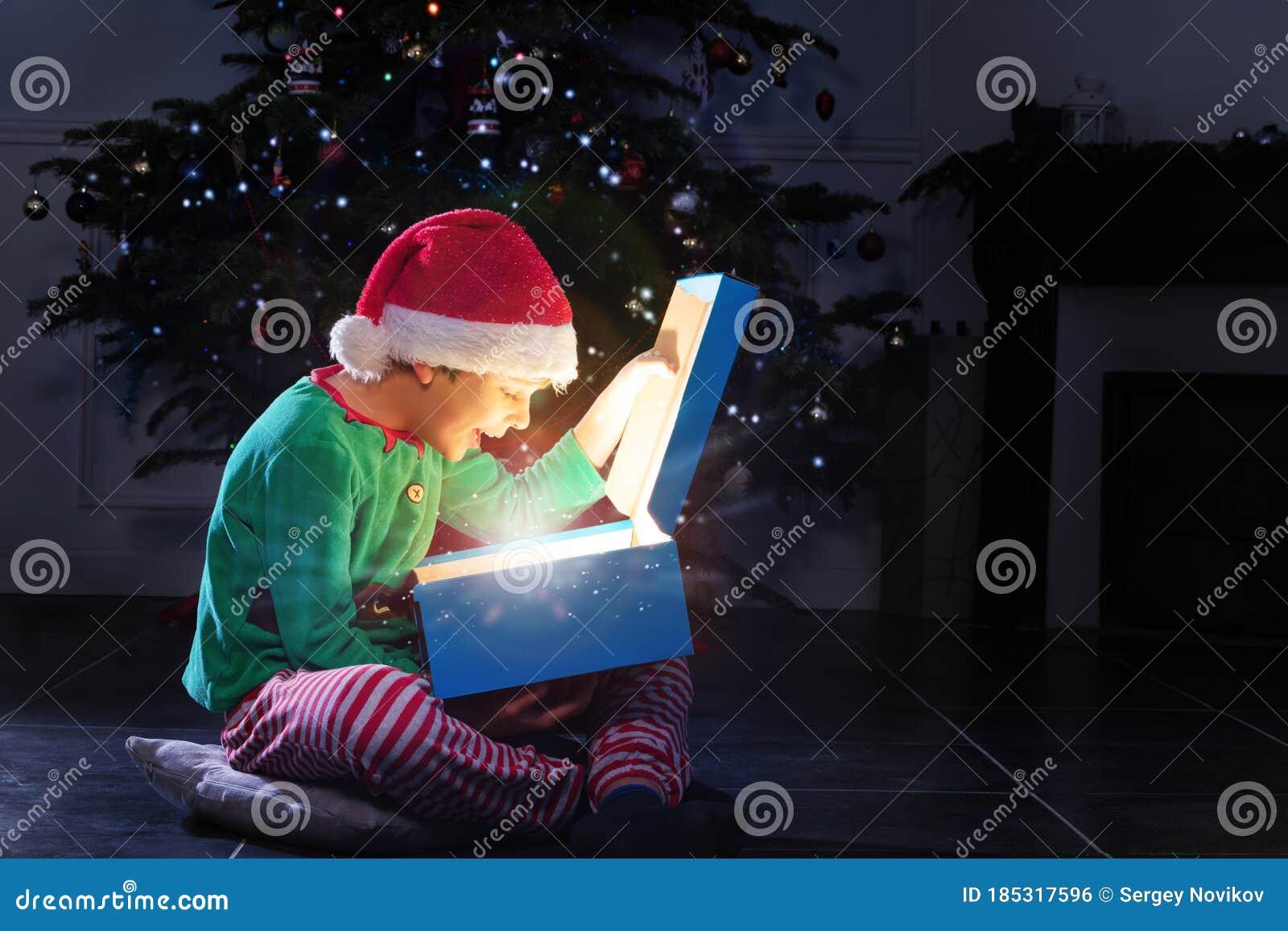 Boy Open Glowing Present Box Near Christmas Tree Stock Photo - Image of kids, magical: 185317596
