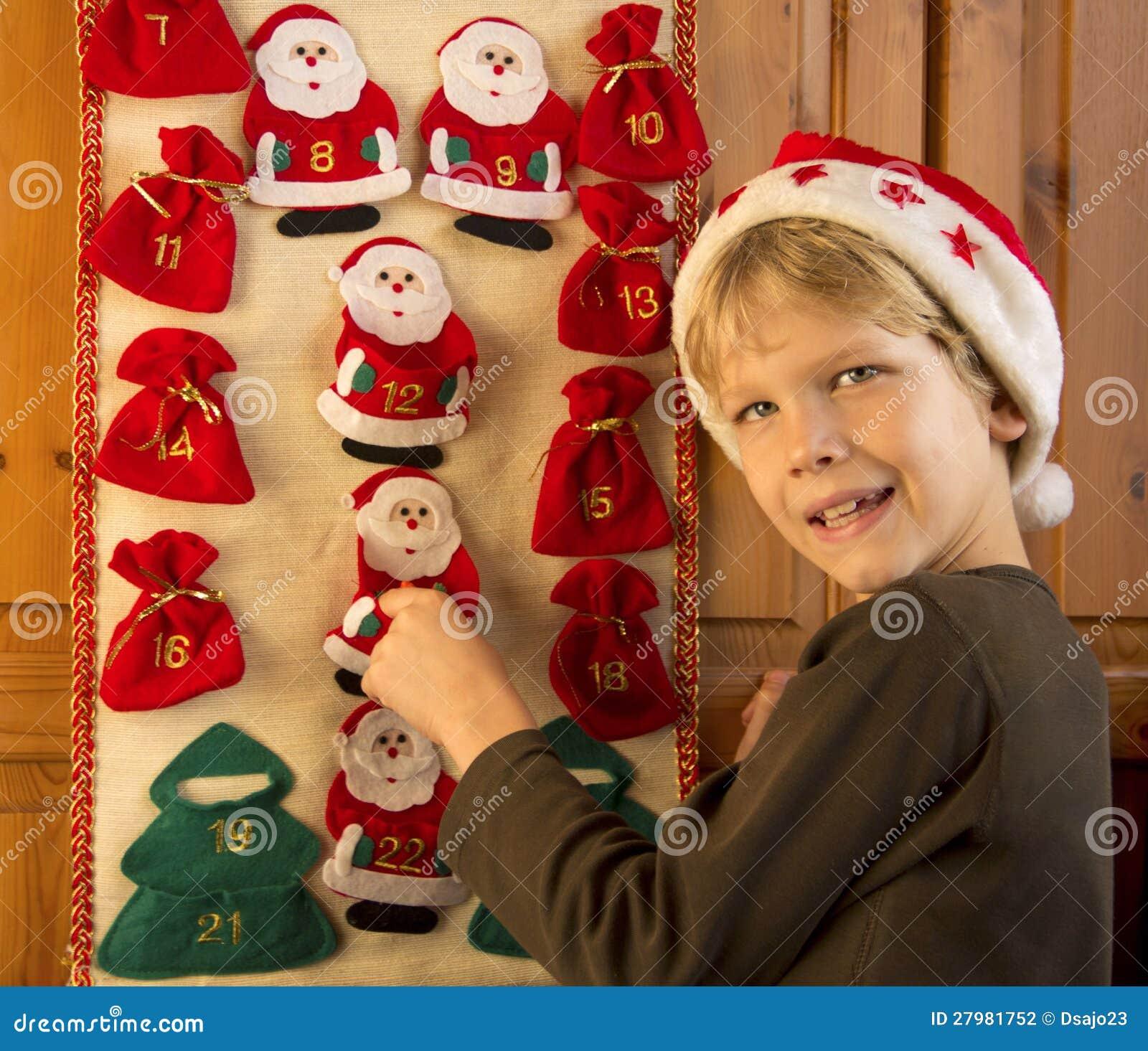 boy opening advent calendar stock photography image. Black Bedroom Furniture Sets. Home Design Ideas