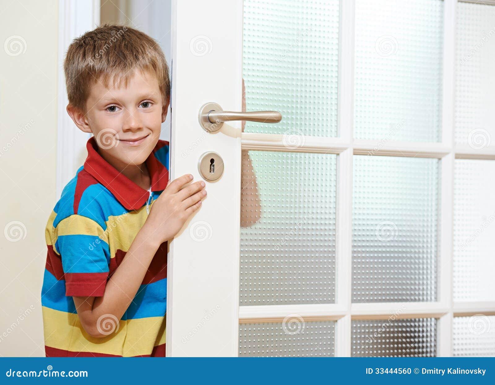 Boy Opening Door Stock Photo Image 33444560