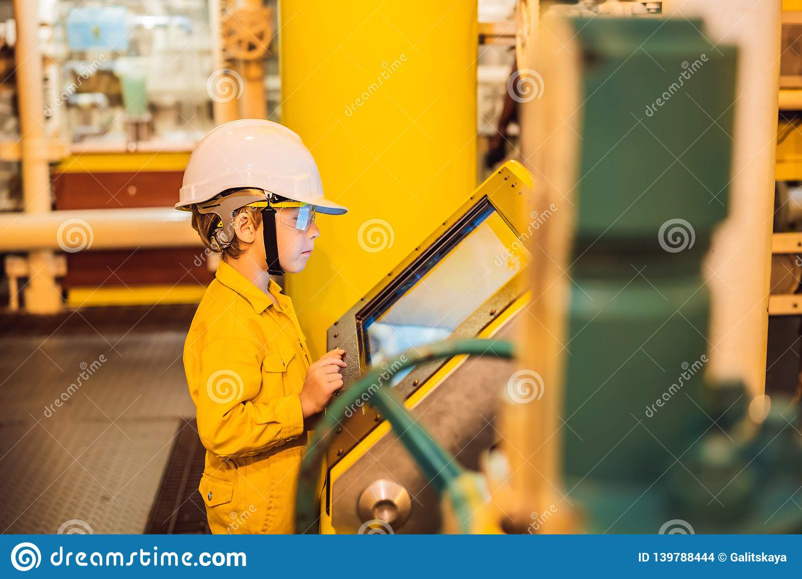 Boy Operator Recording Operation Of Oil And Gas Process At Oil And