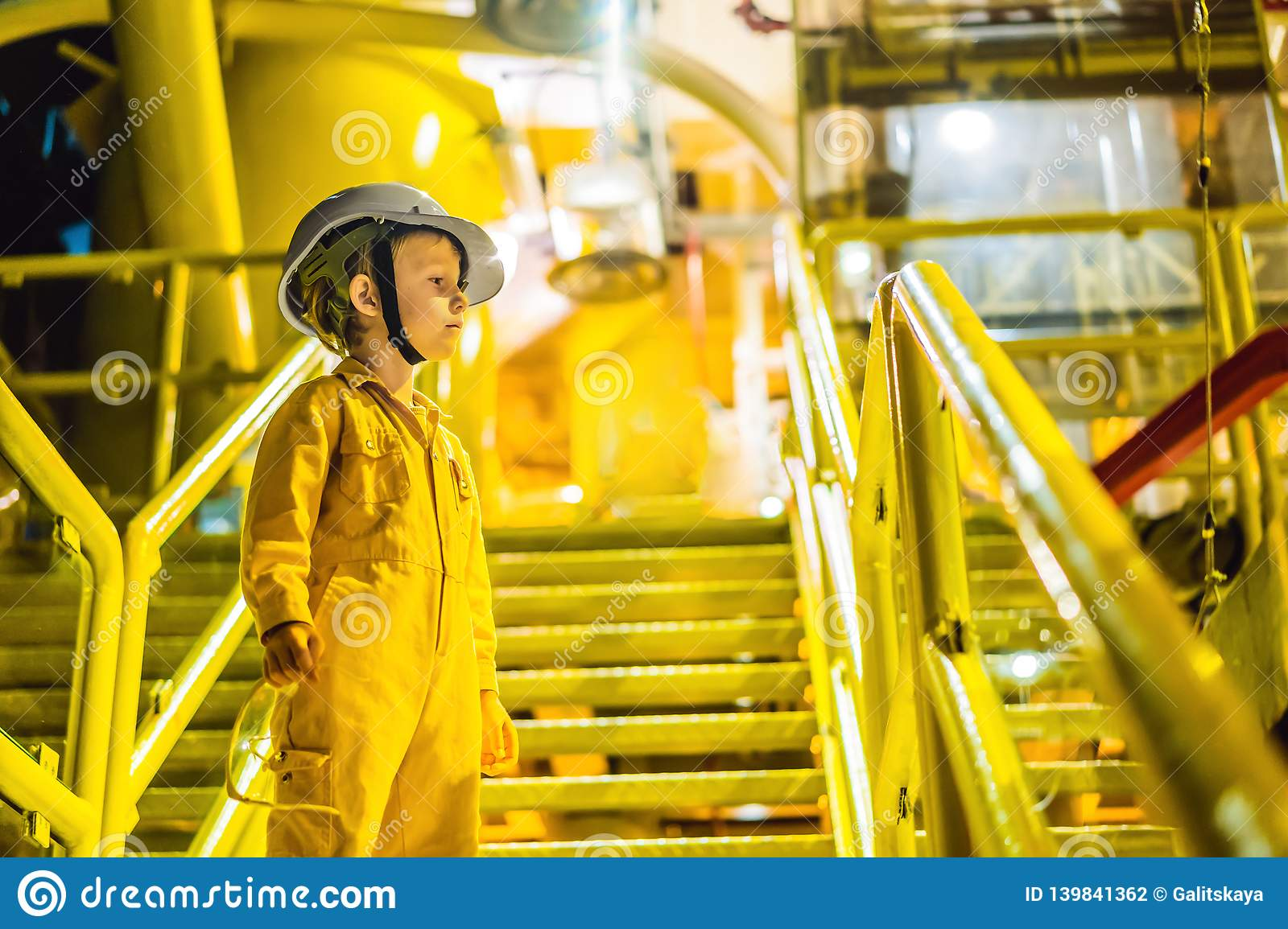Boy operator recording operation of oil and gas process at oil and rig plant, offshore oil and gas industry, offshore