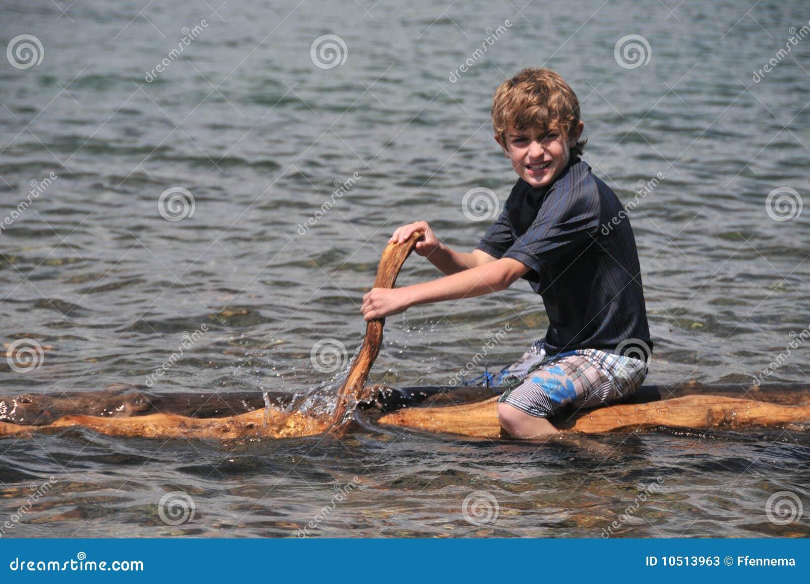 Boy Paddles A Raft On Lake Stock Photos Image 10513963