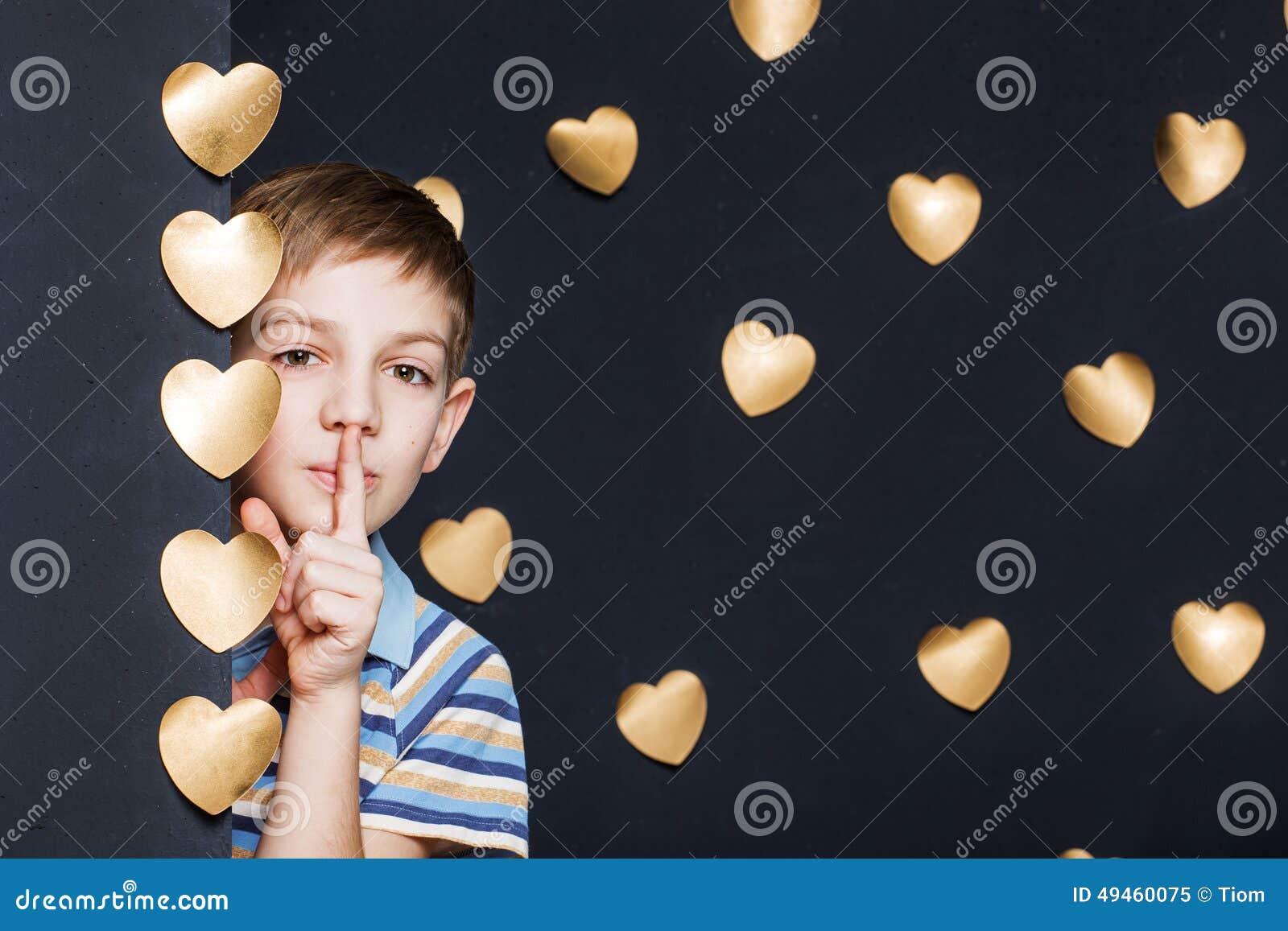 Boy peeking on golden hearts