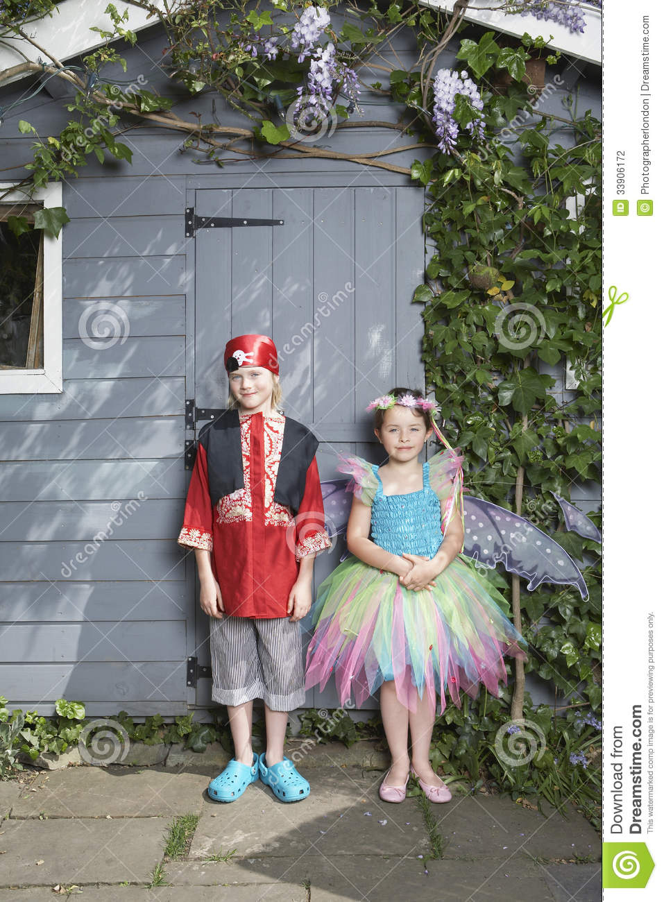 Boy In Pirate And Girl In Fairy Costumes By Shed Stock