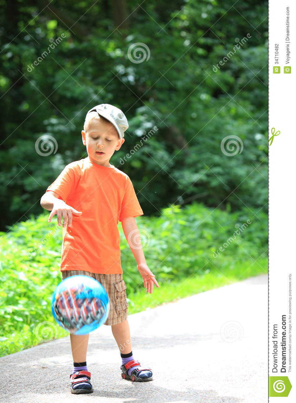 Play With Patterns Prints And Lots Of Accessories For: Boy Playing With Ball In Park Outdoors Stock Photography
