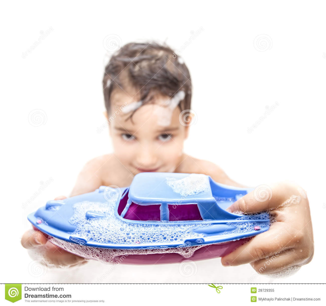 Lillle Boy Toys Boats : Boy playing in the bath with a toy boat royalty free stock