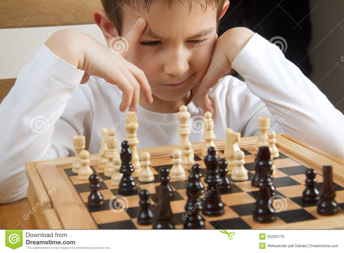 Boy Playing Chess Royalty Free Stock Images - Image: 25230179
