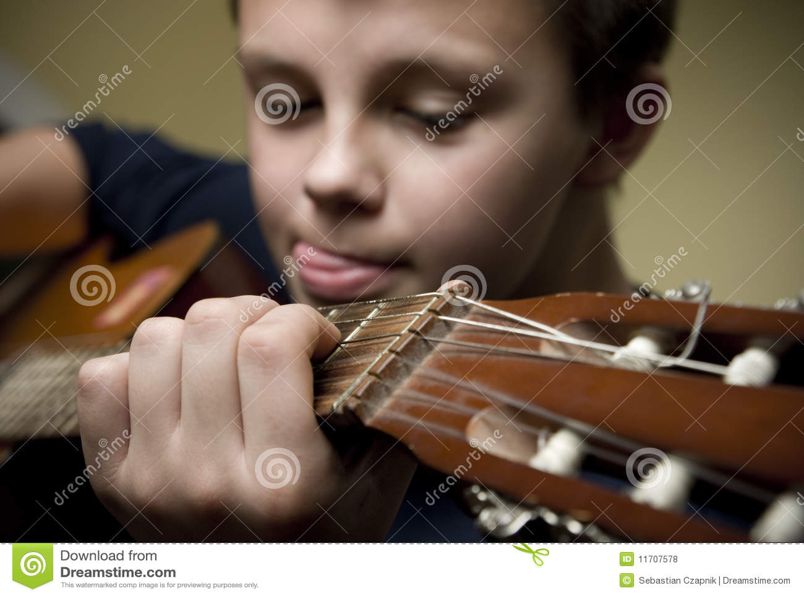 Boy Playing Guitar Royalty Free Stock Photos - Image: 11707578