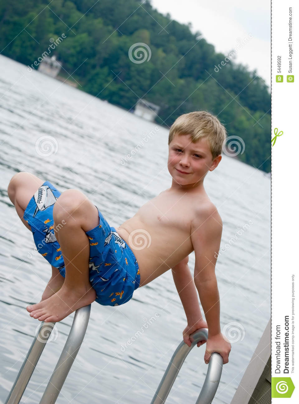 Boy Playing at the Lake