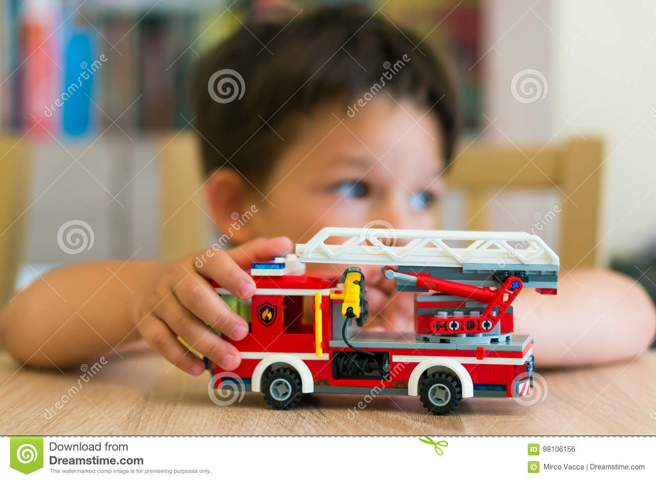 Boy Playing With Lego Fire Truck Editorial Photo Image Of