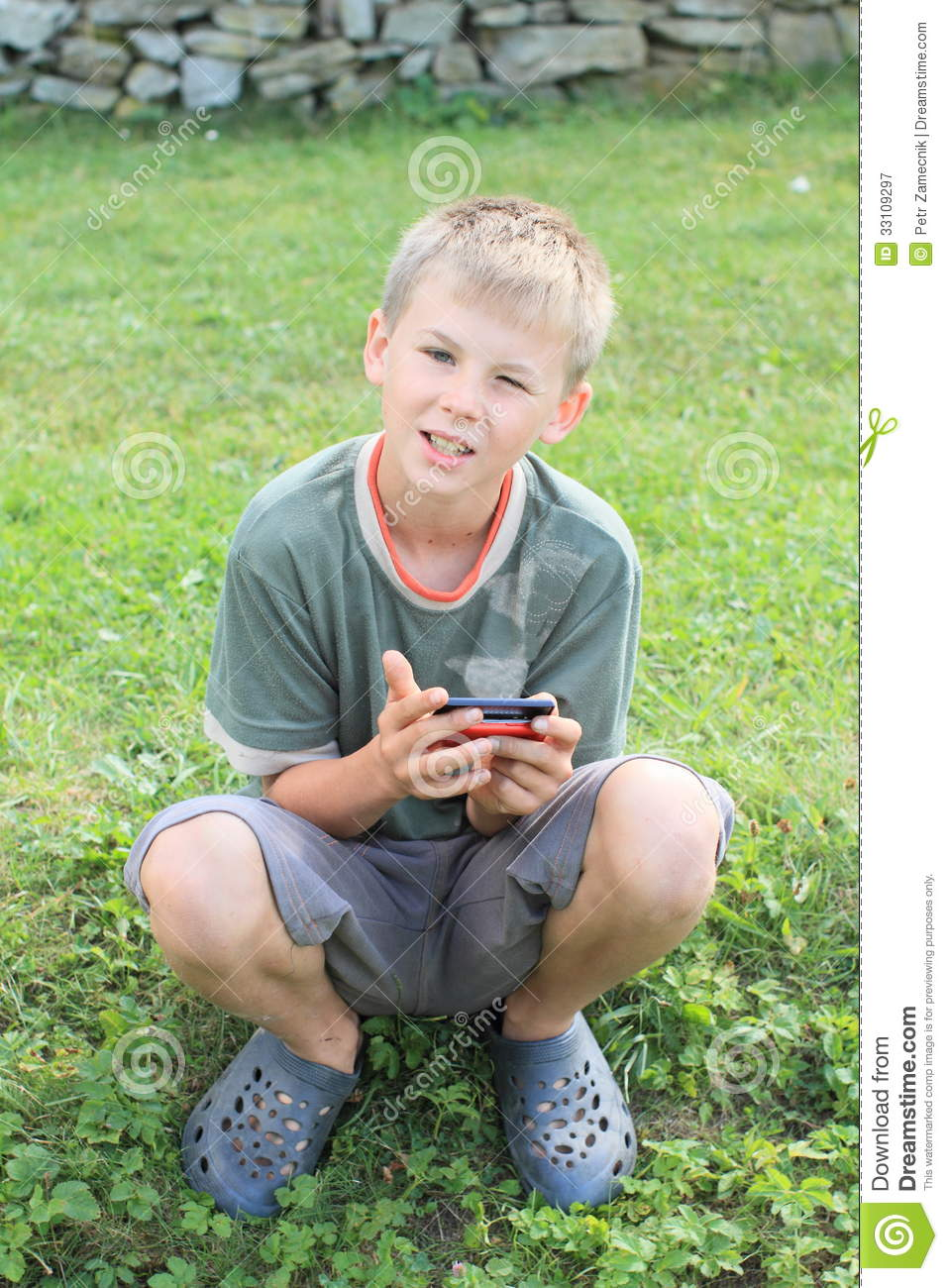 boy playing with mobil phone stock image image 33109297