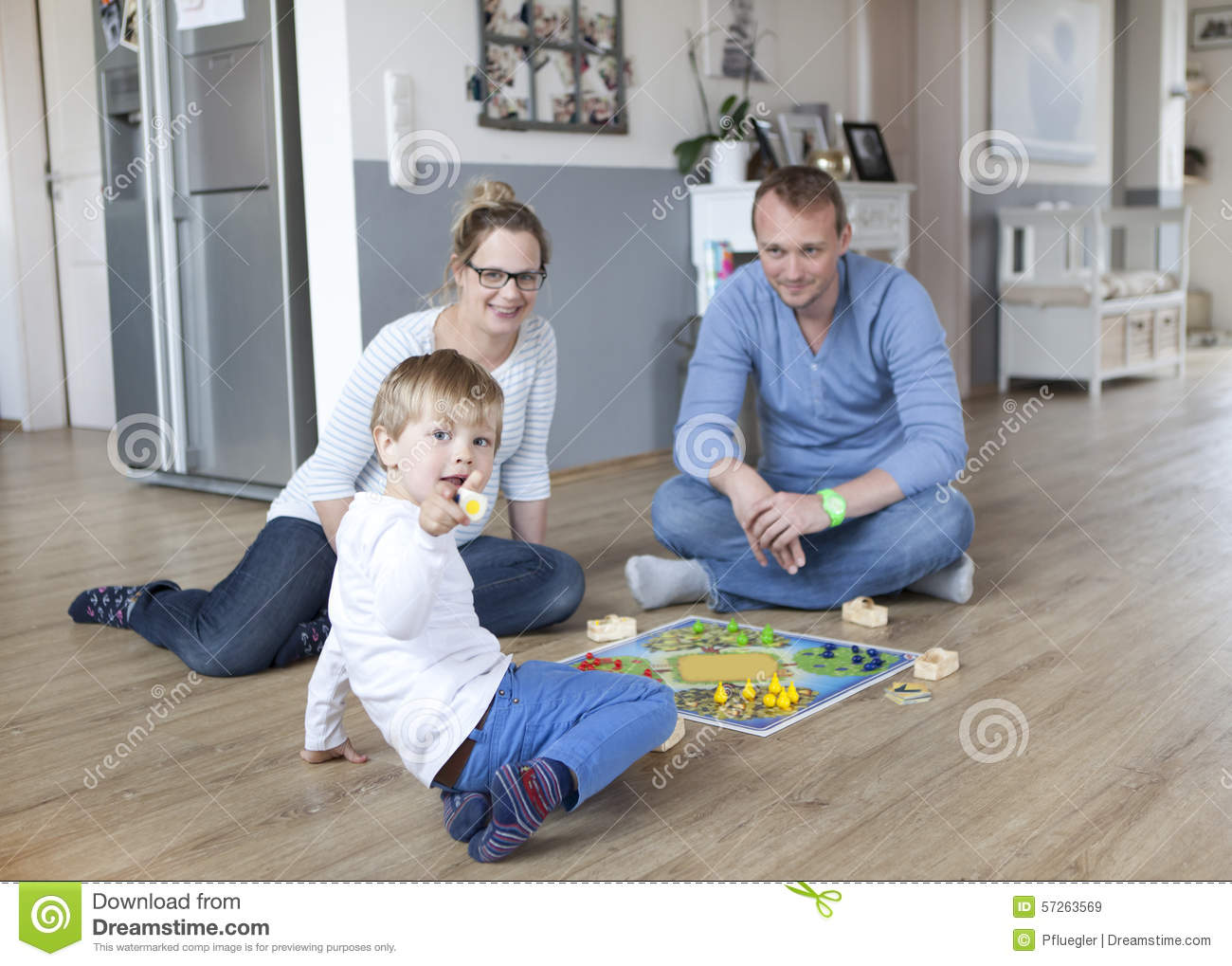 Boy playing with parents stock photo image 57263569 for Family floors