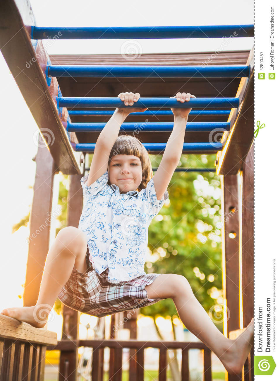 Boy Playing On The Playground Royalty Free Stock