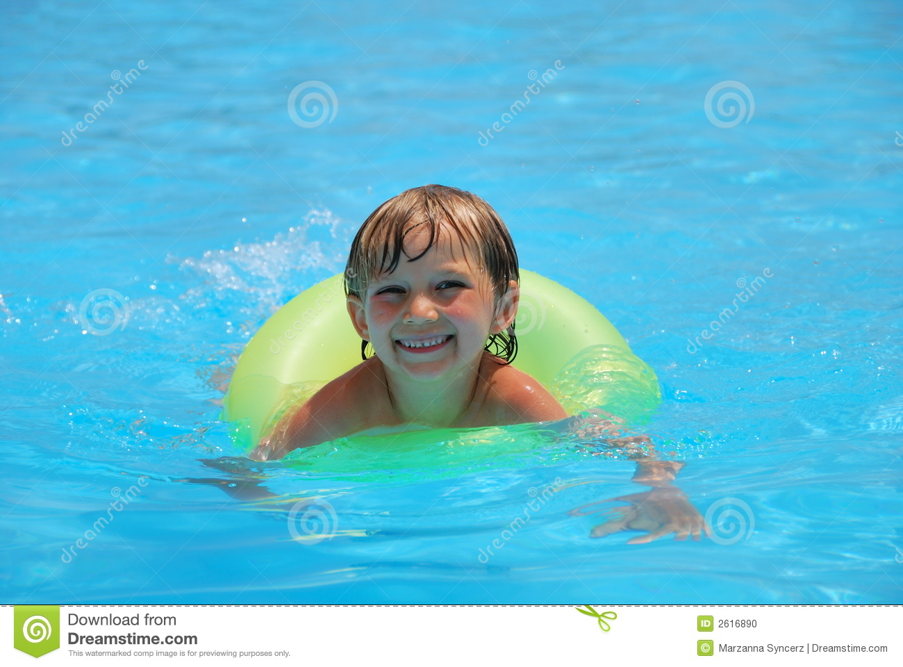 Boy Playing In Pool Inner Tube Stock Photo - Image: 2616890
