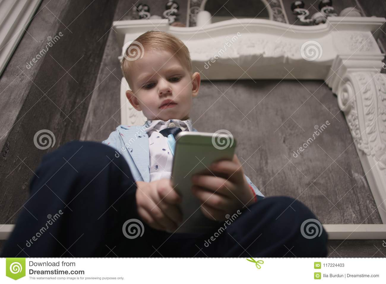 Boy playing smartphone on bed. watching smartphone. kid use phone and play game. child use mobile. addicted game and