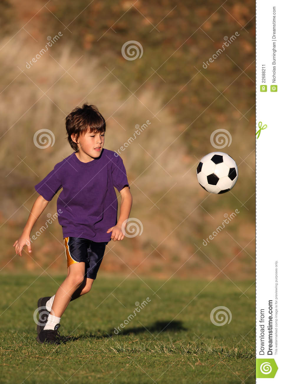 Play With Patterns Prints And Lots Of Accessories For: Boy Playing With Soccer Ball Stock Image